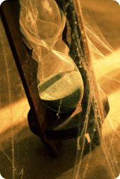 Hourglass with spider web
