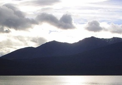 Sunlight on lake with mountain background