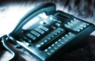 Dramatically lit office phone